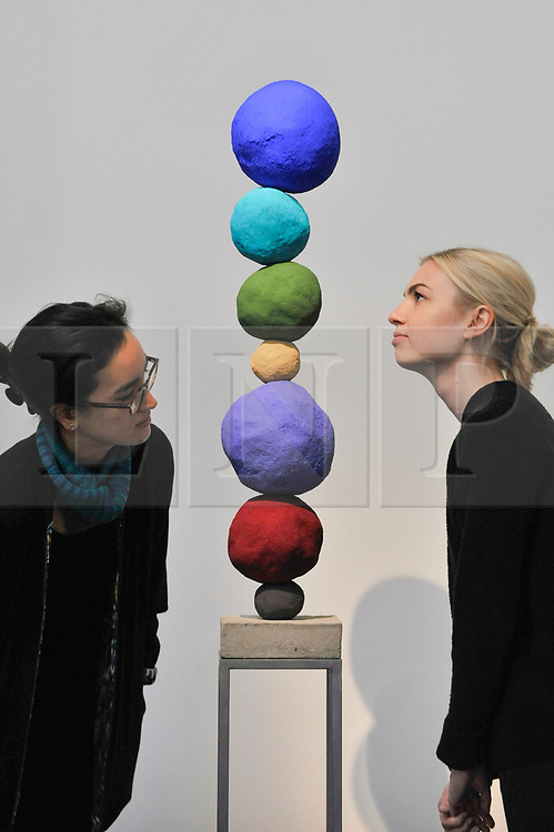 """© Licensed to London News Pictures. 12/10/2017. London, UK.  Staff members view """"Stack 7, Ultramarine Blue"""", 2017, by Annie Morris (Est. GBP5-7k) at a preview of artworks for the """"Art for Grenfell"""" auction taking place at Sotheby's, New Bond Street, on 16 October.  Leading contemporary artists have agreed to donate works to the auction, the proceeds of which will be divided equally amongst the 158 surviving families of the Grenfell Tower fire by the Rugby Portobello Trust charity. Photo credit : Stephen Chung/LNP"""
