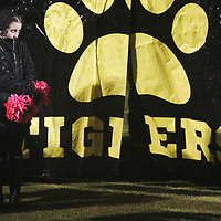 Ripley cheerleader Lily Brewer, 14, tries to stay dry before the start of Friday night's game against New Albany.