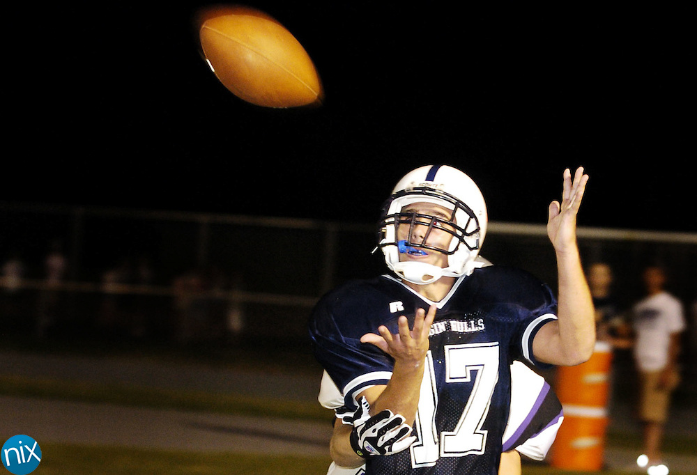 Hickory Ridge's Alex Venuti reaches for a pass in the endzone, but steps out of bounds before making the catch. The Ragin' Bulls went to the air again on the very next play and completed a pass to wide receiver Martin Murrell for the new team's first touchdown at home.