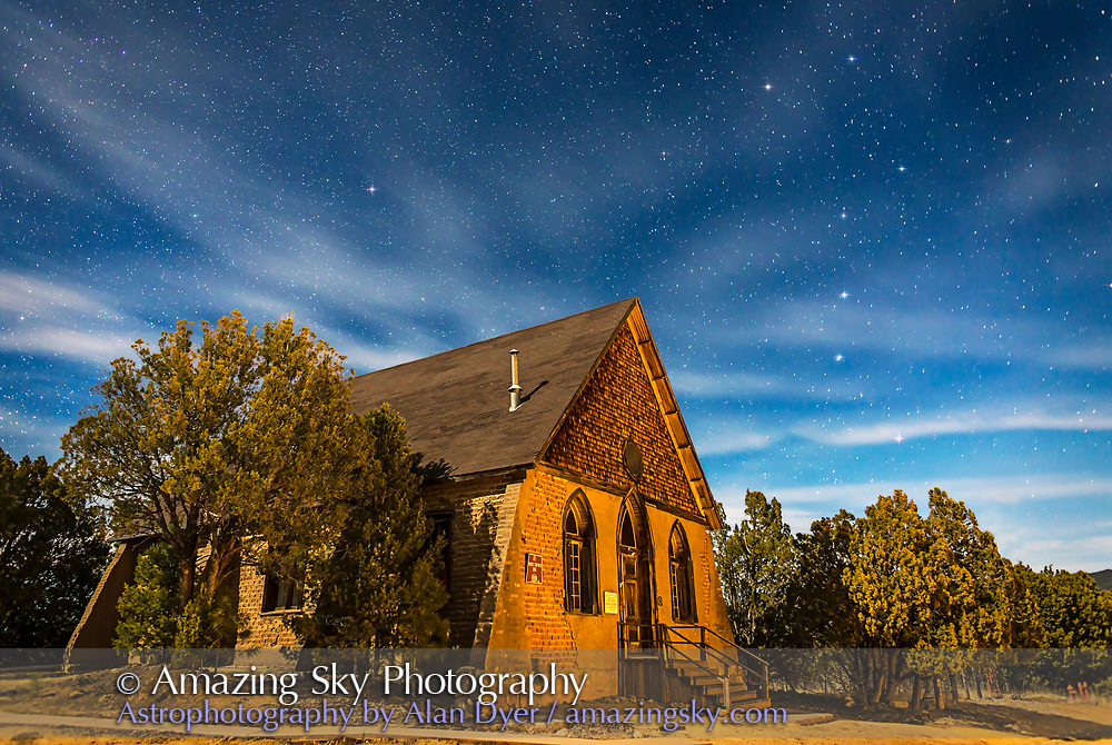 This is a moonlit nightscape of the historic Hearst Church in Pinos Altos, New Mexico, at 7000 feet altitude (thus the name &ldquo;High Pines&rdquo;) and on the Continental Divide. In the sky above, the Big Dipper is at right, and Polaris is at left over the church. <br /> <br /> The Hearst Church opened in May 1898, built with money raised by the local mining families in Pinos Altos, and with a donation from Phoebe Hearst, wife of the mining mogul in the area and senator George Hearst, parents of newspaper tychoon William Randolph Hearst. Gold from the Pinos Altos Hearst mines decorates the Hearst Castle in California. The Hearst Church now serves as an art gallery for the Grant County Art Guild. See http://gcag.org for information.<br /> <br /> This is a single 45-second exposure at f/2.8 with the 24mm lens and Canon 6D at ISO 800. Power lines and poles were cloned out. Taken January 27, 2015 under the light of a first quarter Moon in hazy skies. Warm light from decorative lights in the yard of the house across the street added the reddish glow to the adobe brick. Very nice. Subtle star diffraction spikes added with Astronomy Tools actions.