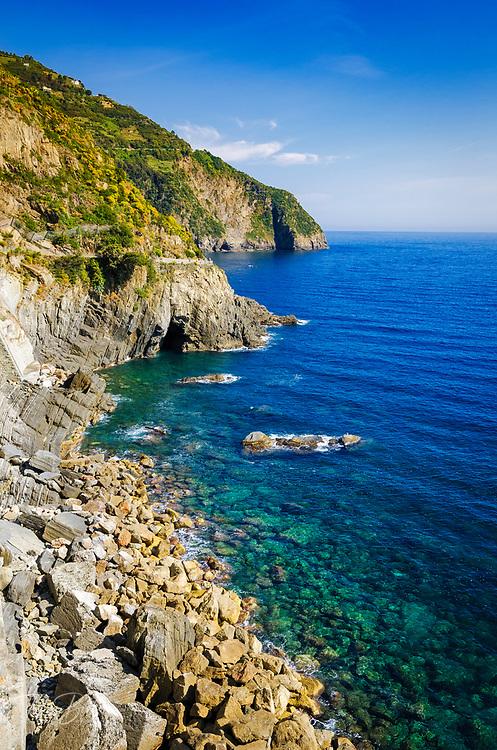 Rocky coastline along the Via dell'Amore (The Way of Love), Riomaggiore, Cinque Terre, Liguria, Italy