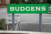 Budgens shop car park, sign and trolley
