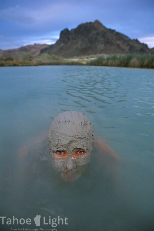 Taking a mud bath in the Black Rock hotsprings in the Black Rock desert near Gerlach, Nevada.