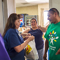 Rachel Morissette of the Gallup Independent greets happy patrons as they pick up their chili dog orders at the company fundraiser. The fundraiser was for held for fellow staff member Mike Peretti's daughter who has battled severe seizure symptoms. Photo taken Aug. 17, 2018.