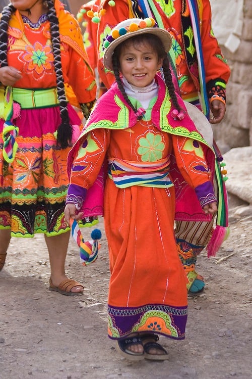 Girl in procession at Pentecostes Festival held annually in May, Ollantaytambo, Peru, South America