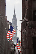 The Chrysler Building from Lexington Avenue, New York City. Stars and Stripes flying below.