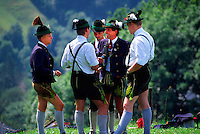 Bavarian men in native costume on Lockstein Mountain, Above Berchtesgaden, Bavaria, Germany