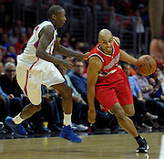 Portland Trail Blazers guard Gerald Henderson #9 gets around Los Angeles Clippers guard Jamal Crawford #11 and is then fouled in the 2nd quarter. The Los Angeles Clippers played the Portland Trail Blazers in game 5 of the NBA Western Conference Playoffs first round. Los Angeles, CA.  April 27, 2016. (Photo by John McCoy/Southern California News Group)