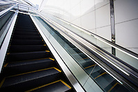 Japan Osaka JR Station man on top of escalator