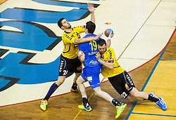 Ivan Sliskovic of Celje PL between Mario Sostaric of Gorenje and Marko Ostir of Gorenje during handball match between RK Gorenje Velenje and RK Celje Pivovarna Lasko in Final match of 1st NLB League - Slovenian Championship 2013/14 on May 23, 2014 in Rdeca dvorana, Velenje, Slovenia. Photo by Vid Ponikvar / Sportida