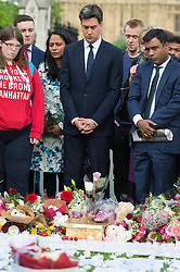 © Licensed to London News Pictures. 17/06/2016. Labour party MP ED MILLIBAND joins well wishers and tributes in Parliament Square in memory of Labour party MP JO COX. She was allegedly attacked and killed by suspect 52 year old Tommy Mair close to Birstall Library near Leeds. London, UK. Photo credit: Ray Tang/LNP
