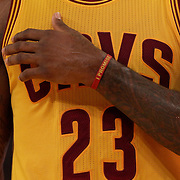 Lebron James, Cleveland Cavaliers, wearing an 'I Promise' wrist band against the New York Knicks. NBA Basketball. Madison Square Garden, New York. USA.  Photo Tim Clayton