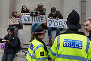 City Police officers chat to environmental activists protest about Climate Change during the blockade outside the Bank of England in the heart of the capital's financial district, the City of London aka the Square Mile, on the seventh day of a two-week prolonged worldwide protest by members of Extinction Rebellion, on 14th October 2019, in London, England.