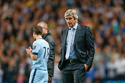 Manager Manuel Pellegrini of Manchester City looks on as acadamy star Jose Angel Pozo of Manchester City is readied to be brought on - Photo mandatory by-line: Rogan Thomson/JMP - 07966 386802 - 24/08/2014 - SPORT - FOOTBALL - Manchester, England - Etihad Stadium - Manchester City v Sheffield Wednesday - Capital One Cup, Third Round.