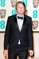 © Licensed to London News Pictures. 14/02/2016. London, UK. TOM HOOPER arrives on the red carpet for the EE British Academy Film Awards 2016 after party held at Grosvenor House . London, UK. Photo credit: Ray Tang/LNPPhoto credit: Ray Tang/LNP