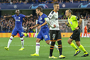 Chelsea defender Fikayo Tomori (29) and Chelsea defender César Azpilicueta (28) celebrate after a VAR hand-ball decision, Valencia forward Rodrigo Moreno (19) laughing, during the Champions League match between Chelsea and Valencia CF at Stamford Bridge, London, England on 17 September 2019.