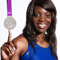 14 August 2012:  Olympic Silver Medalist Endeme Miyem (Team France Basketball) poses with her silver medal, at the Hotel Concorde Lafayette, in Paris, France.
