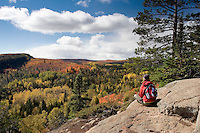 Hiker takes in the view of Superior National Forest along the North Shore of Minnesota.