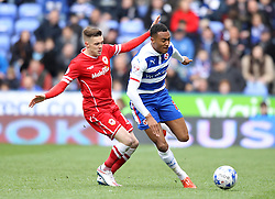 Reading's Jordan Obita skips past Cardiff City's Craig Noone - Photo mandatory by-line: Robbie Stephenson/JMP - Mobile: 07966 386802 - 04/04/2015 - SPORT - Football - Reading - Madejski Stadium - Reading v Cardiff City - Sky Bet Championship