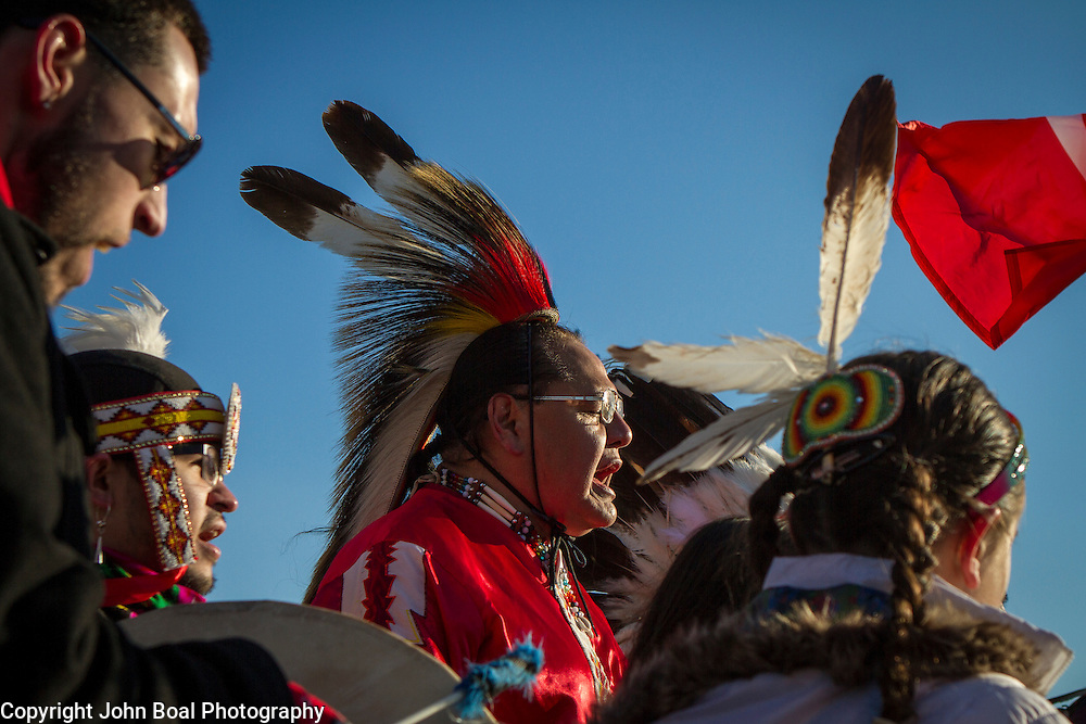 Dennis Zotigh, Kiowa, center, sings and drums with family members during a protest and march from in front of the U.S. Capitol to the EPA, about the North Dakota Access Pipeline, as well as the effort to free Leonard Peltier.  Saturday, December 10, 2016. John Boal Photography