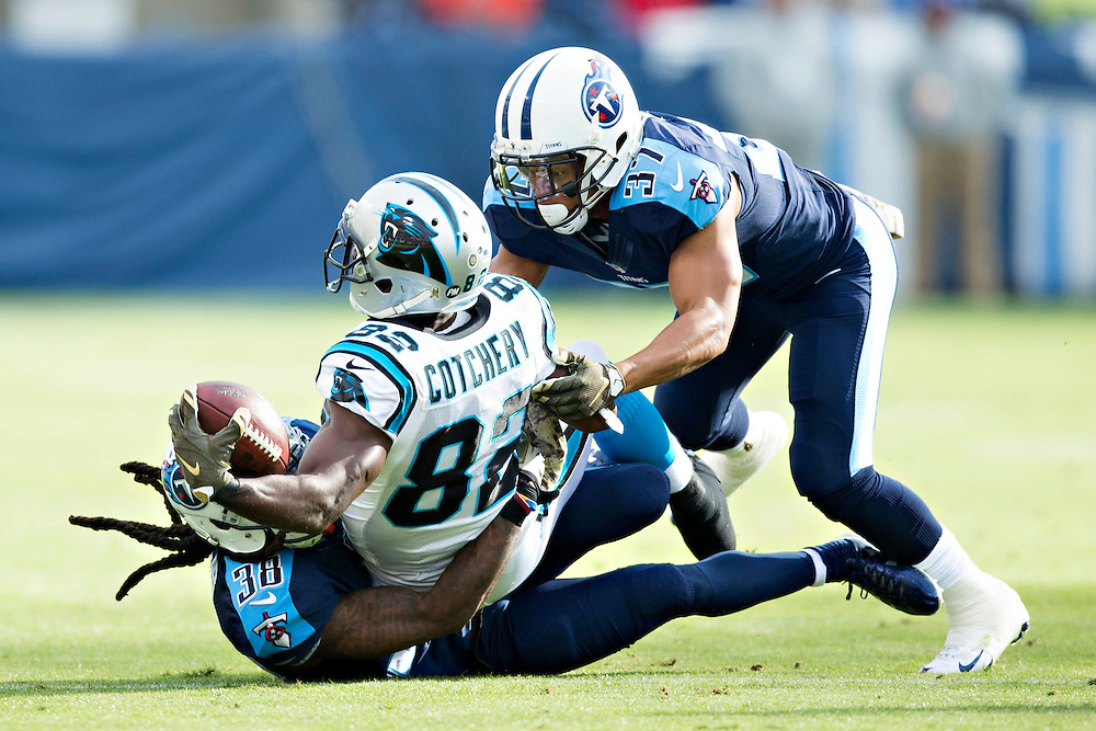 NASHVILLE, TN - NOVEMBER 15:  Cody Riggs #37 and B.W. Webb #38 of the Tennessee Titans tackle Jerricho Cotchery #82 of the Carolina Panthers and force a fumble at Nissan Stadium on November 15, 2015 in Nashville, Tennessee.  (Photo by Wesley Hitt/Getty Images) *** Local Caption *** Cody Riggs; B.W. Webb; Jerricho Cotchery