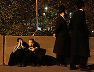 Mourners of the  Grand Rabbi Moses Teitelbaum, worldwide spiritual leader of tens of thousands of members of the ultra-Orthodox Jewish sect, Satmar Hassidim, is sit in the street outside the Yetev Lev D'Satmar synagogue in Brooklyn, New York after he died in New York City at the age of 91 Monday 24 April 2006.