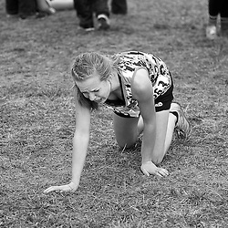 Katie Jo Gebhardt, from Salmon High School, crawls away from the  finish line of the Girls 1A/2A Idaho State Cross Country Championship held at Eagle Island State Park. Gebhardt finished in 12th place with a time of 20:40.5. Saturday November 1, 2014