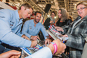 Quadruple Olympic gold medalist; Sir Ben Ainslie (R) does a Q&A  alongside his America's Cup,  J.P. Morgan Bar AC45 Catamaran at the London Boat Show  Here with his crew -  Matt Cornwell - signing autographs. Excel, London, UK  8 January 2014 Guy Bell, 07771 786236, guy@gbphotos.com