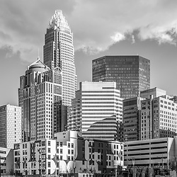 Charlotte downtown city buildings black and white photo. Includes Bank of America Corporate Center, Bank of America Plaza, and 121 West Trade building,. Charlotte, North Carolina is a major city in the Eastern United States of America