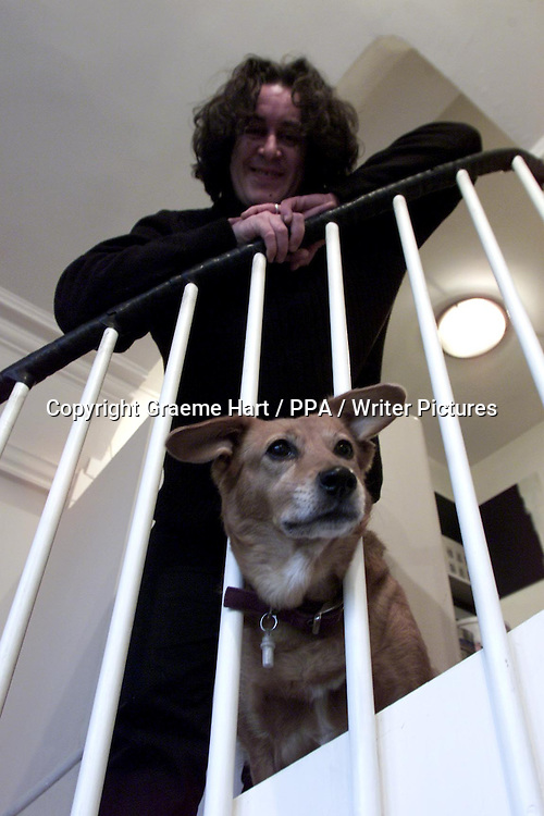 Richard Horne, aka Harry Horse, British author, illustrator and political cartoonist, with his dog 'Roo' at his home near Loch Awe, Argyll and Bute, Scotland, November 22, 2000.<br /> <br /> Graeme Hart / PPA / Writer Pictures<br /> Contact +44 (0)20 822 41564<br /> info@writerpictures.com<br /> www.writerpictures.com