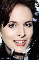 studio shot portrait of a smiling young and beautiful french woman on isolated background