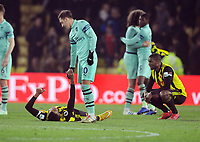 Football - 2018 / 2019 Premier League - Watford vs. Arsenal<br /> <br /> Mesut Ozil of Arsenal consoles the Watford players who played with ten men for most of the match, at Vicarage Road.<br /> <br /> COLORSPORT/ANDREW COWIE