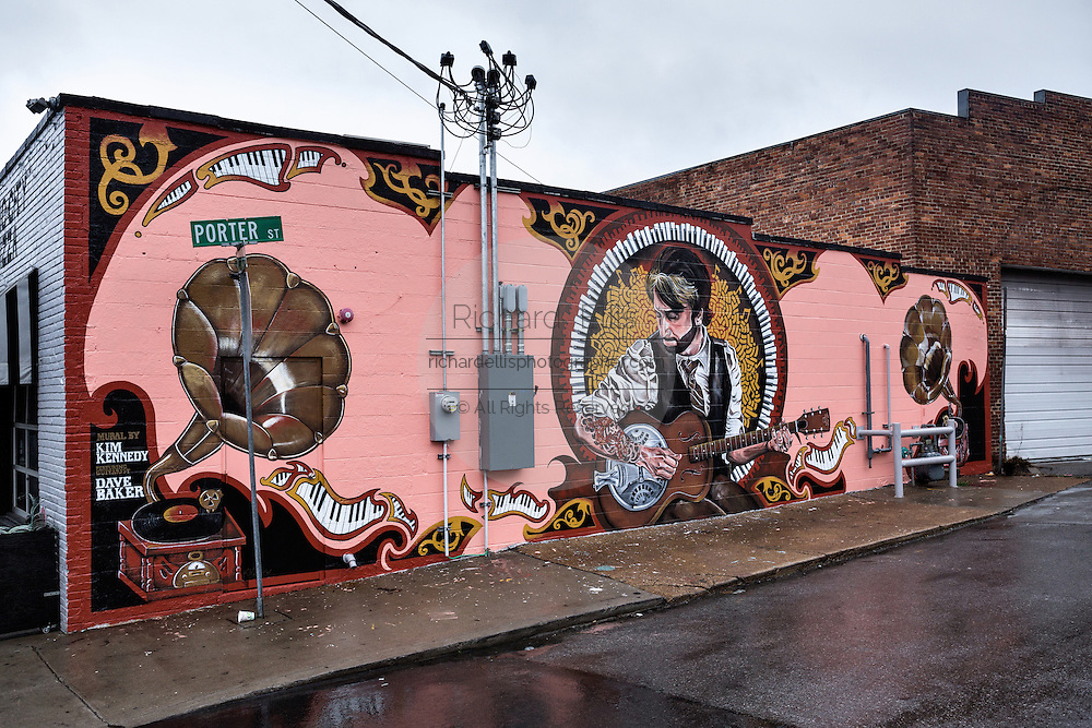 Wall mural by artist and musician Kim Kennedy inspired by guitarist Dave Baker playing a Gibson Dobro on Porter Street in Nashville, TN.