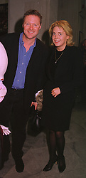 Impressionist RORY BREMNER and MISS ZOE APPLEYARD, at an exhibition in London on 1st October 1998.MKL 27