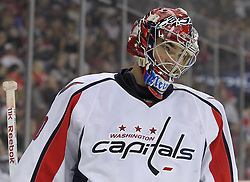Mar 18; Newark, NJ, USA; Washington Capitals goalie Michal Neuvirth (30) takes a break during the second period of their game against the New Jersey Devils at the Prudential Center.