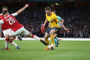 Atletico Madrid attacker Saul Niguez (8) taking on Arsenal defender Shkodran Mustafi (20) during the Europa League semi final first leg match between Arsenal and Atletico Madrid at the Emirates Stadium, London, England on 26 April 2018. Picture by Matthew Redman.