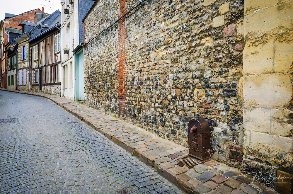 Water fountain and cobblestone street, Honfleur, Normandy, France