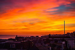 © Licensed to London News Pictures. 29/09/2016. Brighton, UK. A colourful sky as the sun sets over Brighton and Hove. Photo credit: Hugo Michiels/LNP
