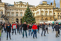 Skaters skating on the temporary (Christmas & New Year) icerink in the courtyard at Somerset House, the Strand, London, UK, 200812051628.<br />