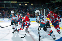 KELOWNA, CANADA -JANUARY 29: Tyrell Goulbourne #12 of the Kelowna Rockets moves the puck out of the corner with Tyson Baillie #24 of the Kelowna Rockets while being checked by Jason Fram D #2 and Carter Proft #15 of the Spokane Chiefs on January 29, 2014 at Prospera Place in Kelowna, British Columbia, Canada.   (Photo by Marissa Baecker/Getty Images)  *** Local Caption *** Tyrell Goulbourne; Tyson Baillie; Carter Proft; Jason Fram;
