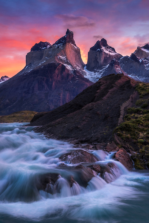 Sunrise light on the Horns of Paine with Salto Grande in the foreground, Torres del Paine National Park, Patagonia, Chile