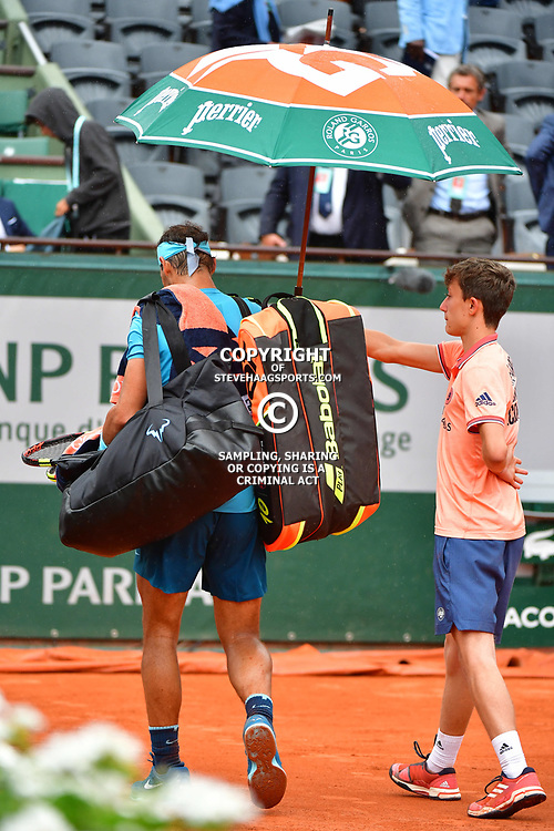 Rafael Nadal of Spain  leaves the court as rain interrupts play during Day 11 of the French Open 2018 on June 6, 2018 in Paris, France. (Photo by Dave Winter/Icon Sport)