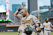 Oakland Athletics left fielder Jonny Gomes acknowledges his teammates after hitting a grand slam against the Minnesota Twins on July 13, 2012 at Target Field in Minneapolis, Minnesota.  The Athletics defeated the Twins 6 to 3.  © 2012 Ben Krause