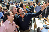 Tim Cook, chief executive officer of Apple Inc., has his photo taken with a customer at an Apple Inc. store in Palo Alto, California, U.S., on Friday, April 10, 2015. From London to Beijing, Apple stores saw few customers lined up before opening Friday as pre-orders started. The first new gadget under Chief Executive Officer Tim Cook is selling in eight countries and Hong Kong, with shipments scheduled to start April 24. Photographer: David Paul Morris