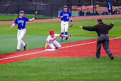 NORMAL, IL - May 01: Joe Butler slides into 3rd with Jake Means covering and is called safe by Mark Huesman during a college baseball game between the ISU Redbirds and the Indiana State Sycamores on May 01 2019 at Duffy Bass Field in Normal, IL. (Photo by Alan Look)