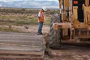 A worker keeps a close eye on heavy construction equiptment at work building new runways at Holloman Air Force Base in Otero County. HAFB received over $21 million to upgrade various facilities as part of the Recovery and Reinvestment Act.