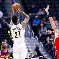 08 March 2017: Denver Nuggets forward Wilson Chandler (21) takes a jump shot o er Washington Wizards center Marcin Gortat (13) during the Washington Wizards 123-113 victory over the Denver Nuggets, at the Pepsi Center, Denver, Colorado, USA.
