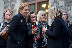 © London News Pictures. 20/11/2012. London, UK . Women members of the Church of England clergy share a joke while looking at an iPhone outside Church House in Westminster, London for day two of the three-day Church of England General Synod. Members will vote on whether to allow women to become bishops, 20 years after the Church decided to ordain women as priests. Photo credit: Ben Cawthra/LNP
