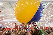 Freshmen, as part of the Orientation process, bounce giant beach balls during a session to meet each other and play games in the Mountaineer Field House.