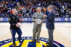 ST. LOUIS, Mo., -- SEC Commissioner Greg Sankey, right, delivered the game ball before Game 01 of the 2018 SEC Men's Basketball Tournament, Wednesday, March 07, 2018 at the Scott Trade Center in ST. LOUIS.